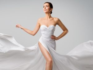 Caucasian Female Wearing Beautiful White Strapless Gown