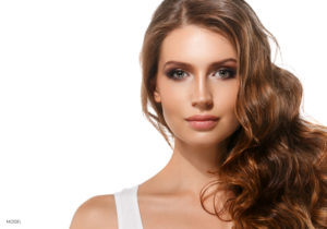 Female In White Tank Top With Long Flowing Wavy Brown Hair