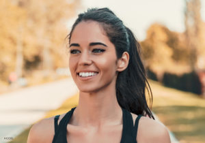 Young Female Running Outdoors Wearing Sunscreen for Skin Protection