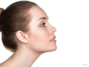 Face of Female With Beautiful Nose And Long Neck With Hair In Bun