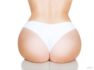 Female Torso of Round Buttocks And Small Waist Wearing White Thong