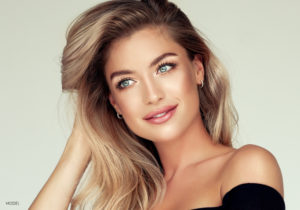 Woman With Beautiful Blond Hair and Clear Blue Eyes With Black Off Shoulder Blouse