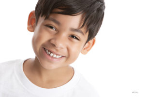 Smiling Young Boy With Ears Sticking Forward